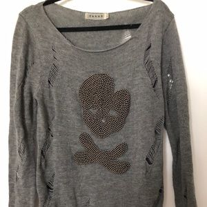 Grey distressed sweater with beaded skull